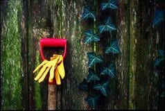 Garden fence. Garden tools against backyard fence royalty free stock photos
