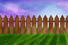 Garden fence. Blue sky, green grass, the sun's rays. There is space for text Stock Photo