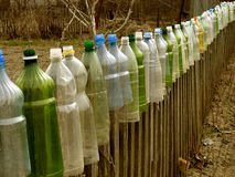 Garden fence with plastic bottles Royalty Free Stock Photos