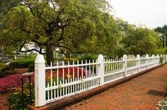 Garden Fence. A white fence in the garden Stock Photography