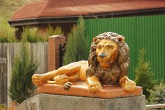 Garden figures. A lion. Figure in the form of animals stock photos