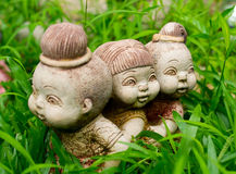 Garden figurines. A stone statue, garden decoration stock photo