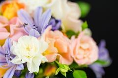 Garden flower bouquet close up on black background Stock Photo