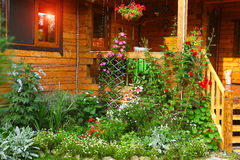 Garden with flowerbed and house porch Royalty Free Stock Photography
