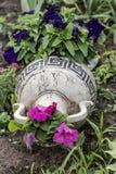 Garden flowers in decorative landscape vase Stock Photography