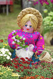 Garden flowers doll Royalty Free Stock Images