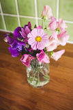 Garden Flowers in a Jar on Kitchen Table Royalty Free Stock Photo