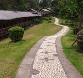 Garden footpath, long ornamental stone walkway Royalty Free Stock Photography