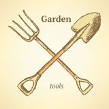 Garden fork and shovel,  background in sketch style Royalty Free Stock Photo