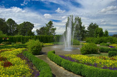 Garden with fountain. A fountain in the middle of a garden Stock Images