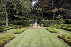 Garden Fountain. An english garden with a fountain spraying in the center Royalty Free Stock Photo