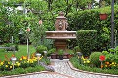 Garden. Fountain among flowers in the garden Stock Photo