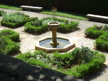Garden fountain. One of many garden found in Monaco with water features and herbs stock images