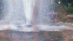 Garden fountain. Splashing streams of water fountain in slow motion stock video footage