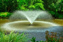 Garden fountain with splashing water Royalty Free Stock Photos