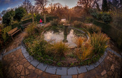 Garden fountain at sunset Stock Photography