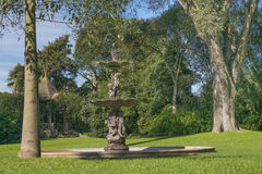 Garden with Fountain at Villa Ocampo in San Isidro Buenos Aires-. Garden with big trees and fountain at Villa Ocampo, and old style classic building of San Royalty Free Stock Photo