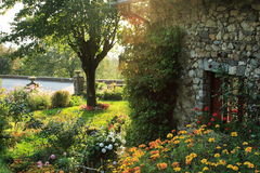 Garden in the french countryside. With an old typical house Royalty Free Stock Photo