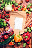 Garden fresh vegetables and blank brown paper Royalty Free Stock Images