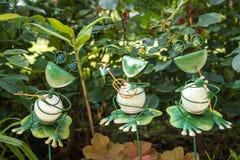 Garden frog band. Three garden frog band toys Royalty Free Stock Photography