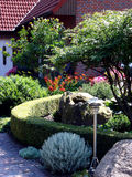 Garden in front of the house Stock Images