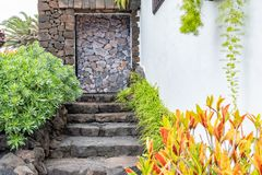 Garden in front of house of the Jameos del Agua with pool and colorful trees, Lanzarote, Canary Islands, Spain.  stock photos