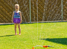 Garden fun with a sprinkler Stock Photos