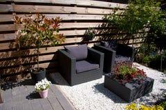 Garden furniture. In a modern garden Stock Images