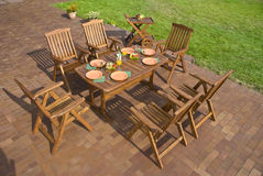 Garden furniture. The Garden furniture at the patio w place setting Stock Photos