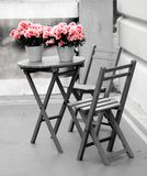 Garden furniture. Wooden garden furniture with small pot's and flower's Stock Images