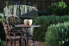 Garden furniture. Garden nook detail with table and chairs Royalty Free Stock Photo