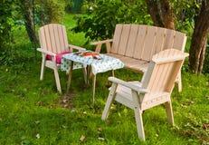 Garden furniture. On a green garden lawn Stock Photo