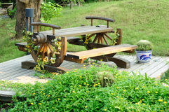 Garden furniture. And flowerpot of  cactus on a  wooden floor at garden ,in front of mother chrysanthemum Royalty Free Stock Photos