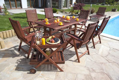 Garden furniture. The Garden furniture by the house and the pool Stock Photo