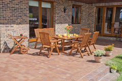 Garden furniture. The Garden furniture by the house Stock Photography