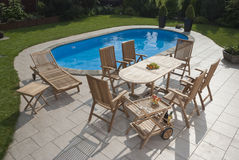 Garden furniture. The Garden furniture by the pool Royalty Free Stock Images