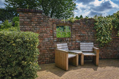 Garden furniture against the wall. Royalty Free Stock Photography