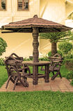 Garden furniture. chairs and table under wooden umbrella at gard Stock Photography