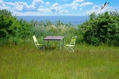 Garden furniture on a green lawn Royalty Free Stock Photos