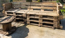 Garden furniture made by hand from old used europallets royalty free stock photo