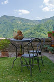 Garden furniture overlooking mountain scenery Stock Photography