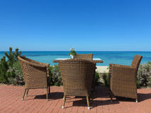 Garden furniture by the sea Royalty Free Stock Photos