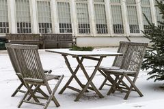 Garden furniture with snow. The photo shows snow-covered garden furniture royalty free stock photo