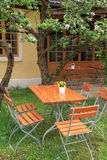 Garden furniture under a blossoming apple tree Royalty Free Stock Photo