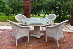 Garden furniture. White table and chairs patio furniture in a garden's gazibo Royalty Free Stock Photo