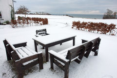 Garden furniture in winter time Stock Photos