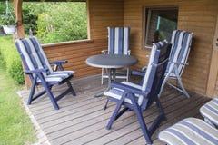 Garden furnitures. Garden seats and table beside of a garden house Stock Photo