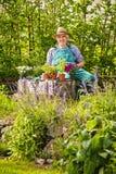 Garden gardener plants straw hat sitting Stock Photo