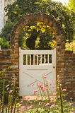 Garden gate. White garden gate with brick archway Stock Photos