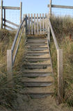 Garden Gate. A garden gate and steps leading out to dunes and the beach royalty free stock photo